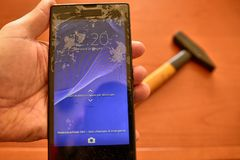 Close up on a smartphone screen with a broken screen royalty free stock photography