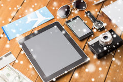 Close up of smartphone and travel stuff Royalty Free Stock Image