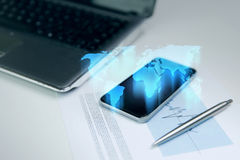 Close up of smartphone with world map hologram Stock Photos