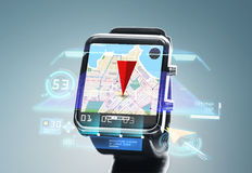 Close up of smartwatch with navigator map. Modern technology, travel, navigation, object and location concept - close up of black smartwatch with navigator map Stock Photography