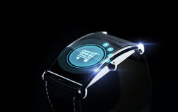 Close up of smartwatch with shopping cart icon Royalty Free Stock Photos