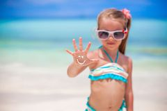 Close-up of smile made by sun cream ??on girl's. Hand. This image has attached release Royalty Free Stock Photos