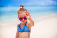 Close-up of smile made by sun cream ??on palm. Little girl. This image has attached release Royalty Free Stock Images