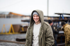 Close up of smile man wearing winter jacket royalty free stock photography