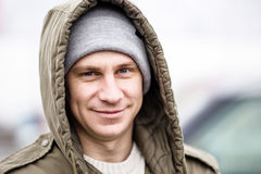 Close up of smile man wearing winter jacket stock photo
