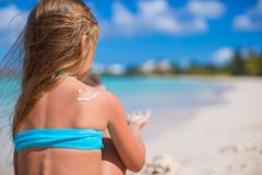 Close-up smile painted by sun cream on kid. 's shoulder Royalty Free Stock Photo