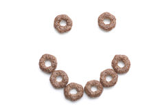 Close-up of a smile of round, brown breakfast cereals. Royalty Free Stock Photo