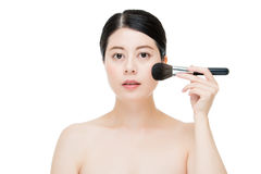 Close up of Smile woman with makeup brushes near face Stock Images