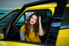 Close up of smiley woman in the car with door opened Royalty Free Stock Photo