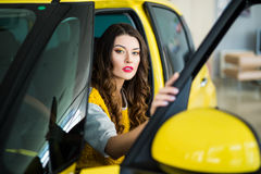 Close up of smiley woman in the car with door opened Royalty Free Stock Images