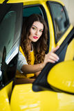 Close up of smiley woman in the car with door opened Stock Photo