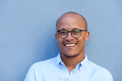 Close up smiling african american businessman with glasses. Close up portrait of smiling african american businessman with glasses Stock Photography