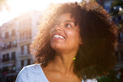 Close up smiling african american woman outside in city Royalty Free Stock Photos