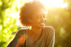 Close up smiling african american woman with sunset Royalty Free Stock Image