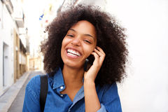 Close up smiling african american woman talking on smart phone Stock Image