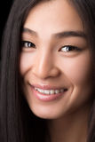 Close-up of smiling Asian woman in studio Stock Photo