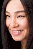 Close-up of smiling Asian woman in studio Stock Photography
