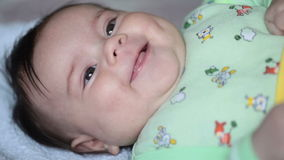 Close up of smiling baby's face. FullHD video Stock Photo