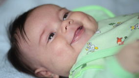 Close up of smiling baby's face. FullHD video Royalty Free Stock Photo