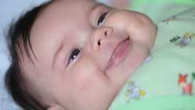 Close up of smiling baby's face. FullHD video Royalty Free Stock Photos