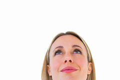 Close up of smiling blonde woman looking up Stock Image