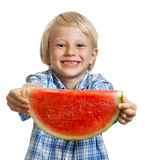 Close-up of smiling boy holding out slice of water melon Royalty Free Stock Image