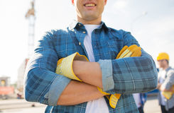 Close up of smiling builder hands in gloves Stock Photo
