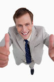 Close up of smiling businessman giving thumbs up Stock Photos