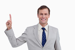 Close up of smiling businessman pointing up Royalty Free Stock Images