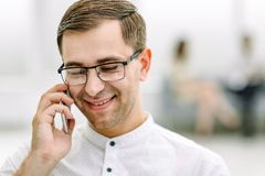 Close up.smiling businessman talking on his smartphone stock photography