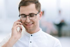 Close up.smiling businessman talking on his smartphone. Business concept stock images