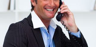 Close-up of a smiling businessman talking on phone Stock Photo