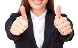 Close-up of smiling businesswoman doing thumbs up Stock Photo