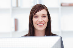 Close-up of a smiling businesswoman at work Stock Image