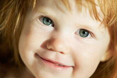 Close-up of smiling child face Stock Image