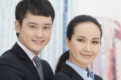Close-up of smiling, confident, young business man and woman, portrait Stock Photography