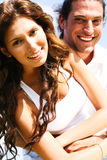 Close-up of smiling couple. Couple in love smiling at camera and having fun Royalty Free Stock Photo