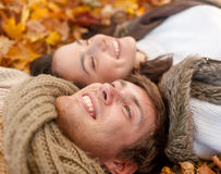 Close up of smiling couple lying in autumn park Stock Images