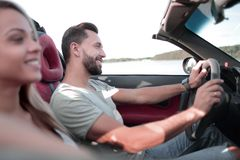 Close up.smiling couple sitting in a convertible car stock photos