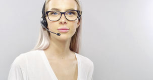 Close-up of a smiling customer service or support representative with headset Stock Image