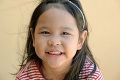 Close up of smiling cute little girl Stock Photos