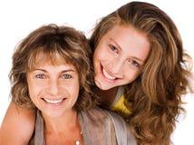 Close-up of smiling elder mum and daughter royalty free stock image