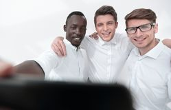 Close up.smiling employees taking a selfie. People and technology stock image