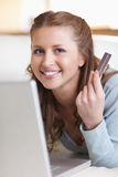 Close up of smiling female booking a flight online Stock Photo