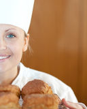 Close-up of a smiling female chef baking scones Stock Photo