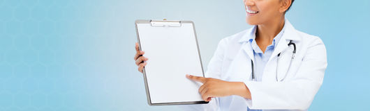 Close up of smiling female doctor with clipboard Royalty Free Stock Photo