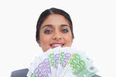 Close up of smiling female entrepreneur with money Stock Photo
