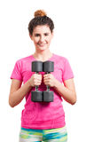 Close-up of smiling female exercising with dumbbells Stock Photo