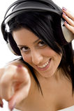 Close up of smiling female holding headphone Royalty Free Stock Image