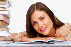 Close-up of a smiling female student. With books Stock Image